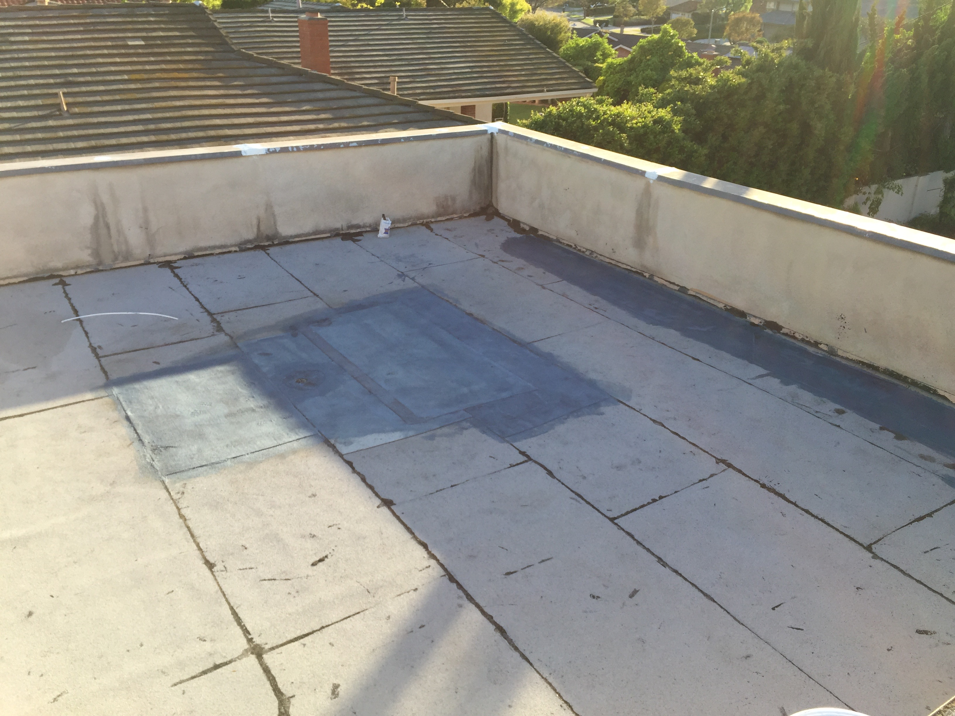 Flat roof solar guard coating system waterproofing for Flat roof waterproofing paint